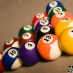 Fifteen balls over a billard table. Racked and ready to go!
